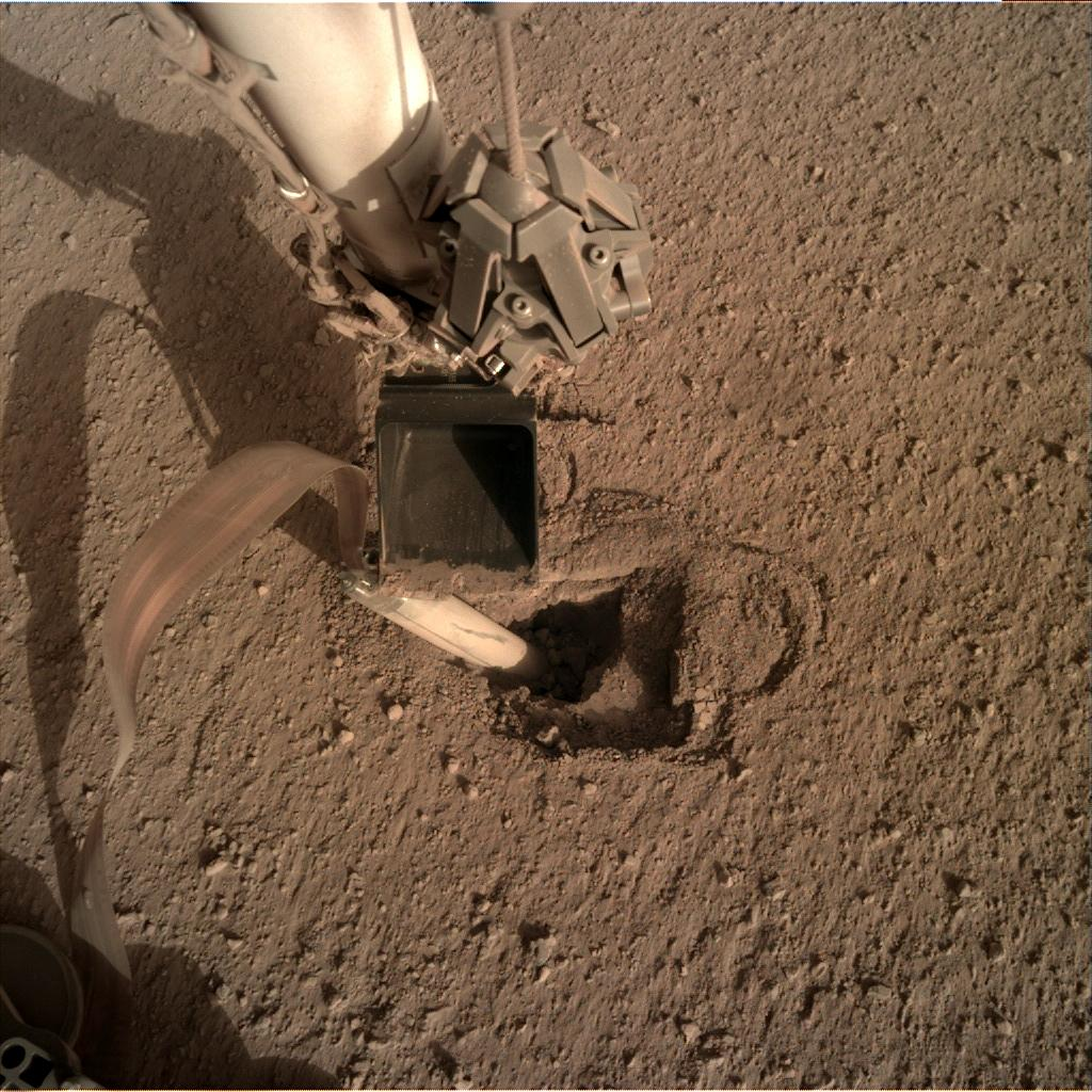 Nasa's Mars lander InSight acquired this image using its Instrument Deployment Camera on Sol 437