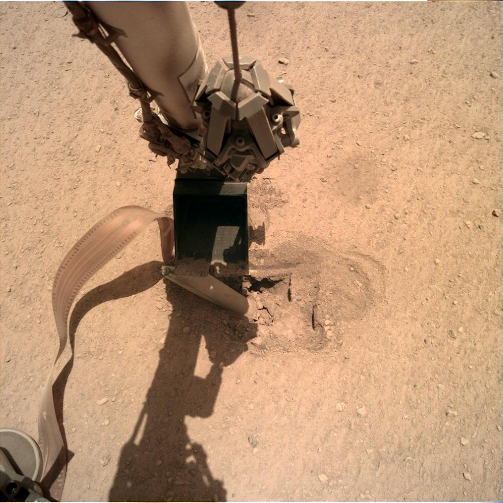 Nasa's Mars lander InSight acquired this image using its Instrument Deployment Camera on Sol 452