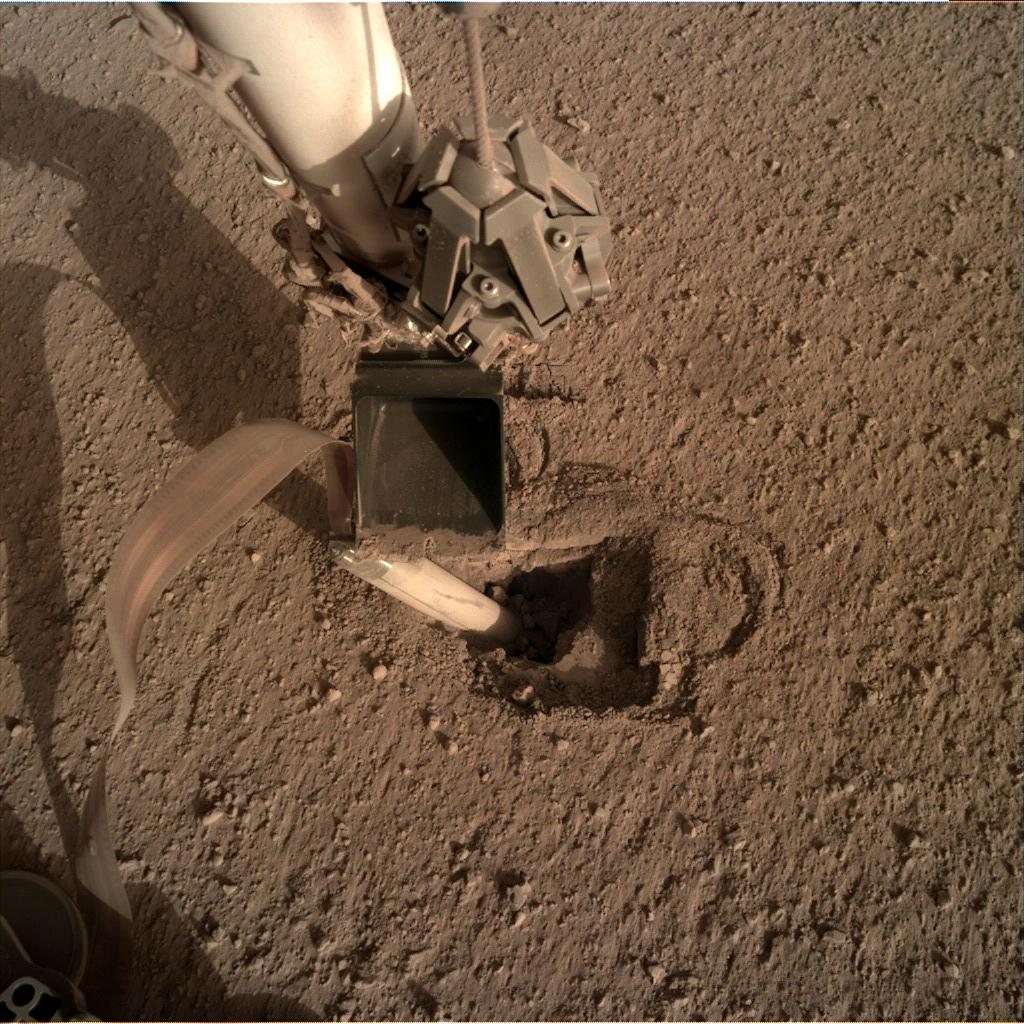 Nasa's Mars lander InSight acquired this image using its Instrument Deployment Camera on Sol 453