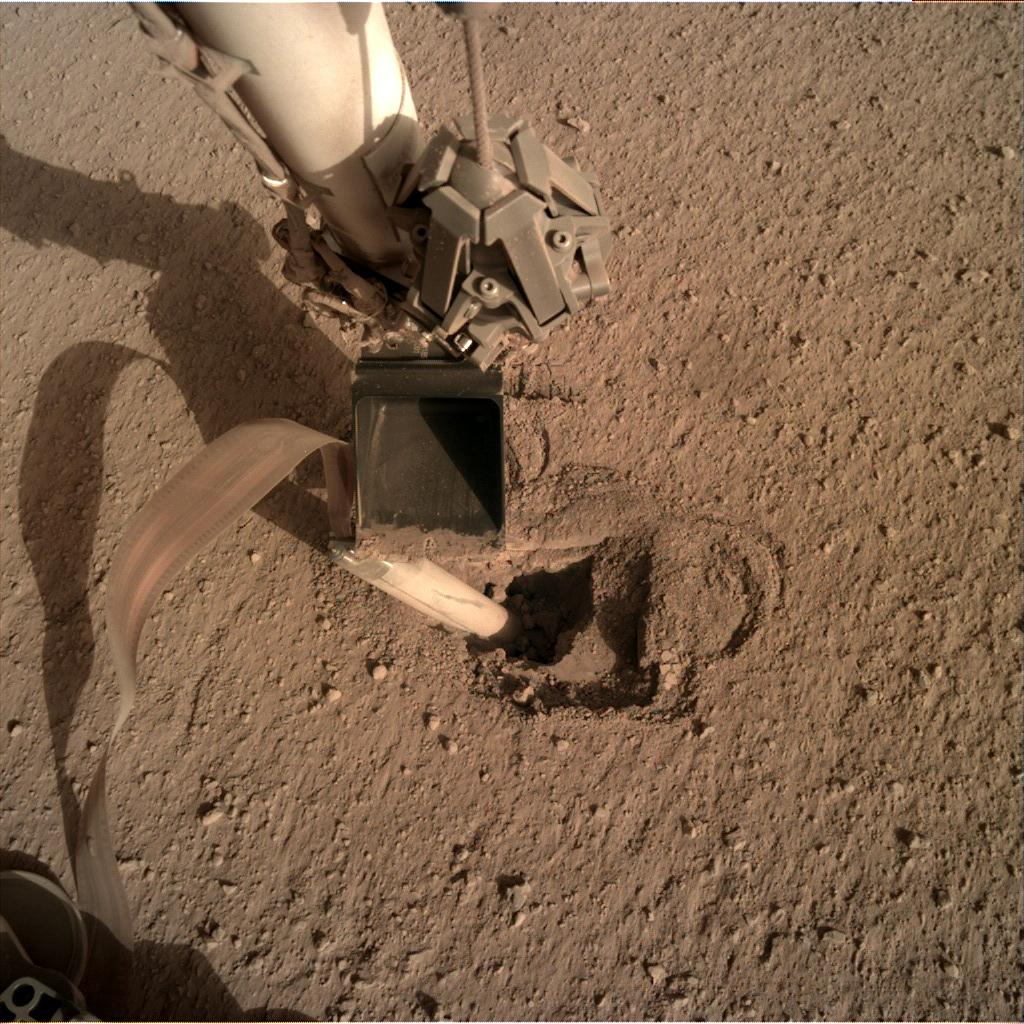 Nasa's Mars lander InSight acquired this image using its Instrument Deployment Camera on Sol 454