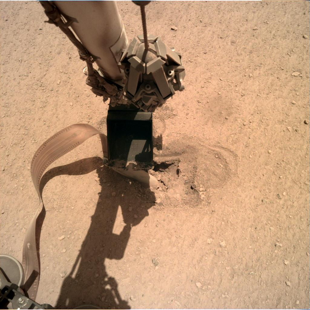 Nasa's Mars lander InSight acquired this image using its Instrument Deployment Camera on Sol 460