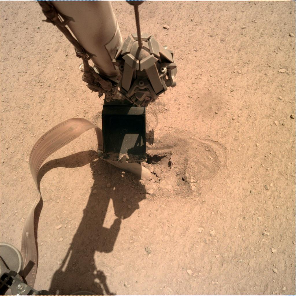 Nasa's Mars lander InSight acquired this image using its Instrument Deployment Camera on Sol 465