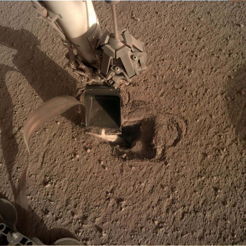 Nasa's Mars lander InSight acquired this image using its Instrument Deployment Camera on Sol 473