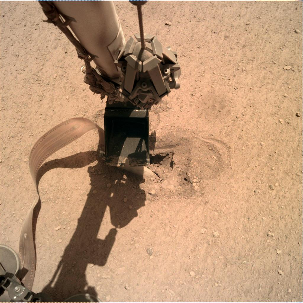 Nasa's Mars lander InSight acquired this image using its Instrument Deployment Camera on Sol 474