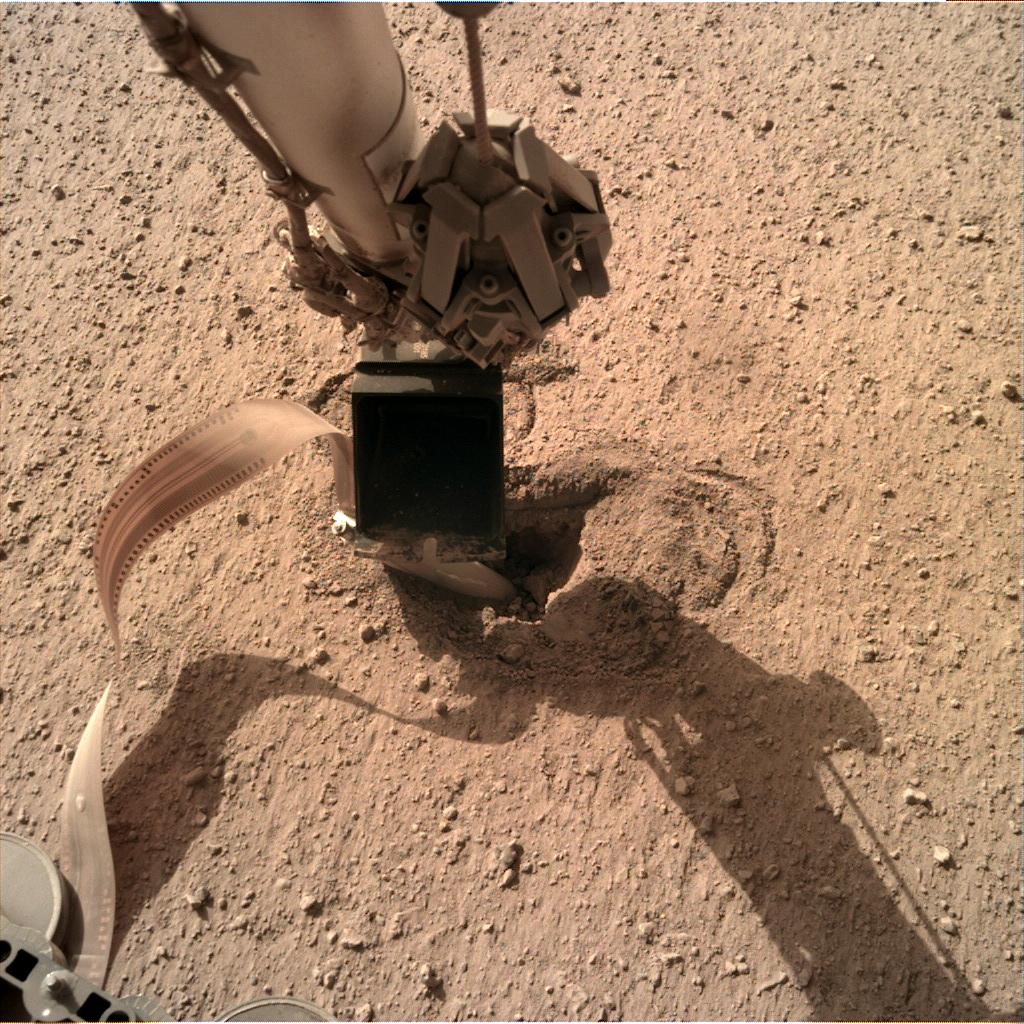 Nasa's Mars lander InSight acquired this image using its Instrument Deployment Camera on Sol 483