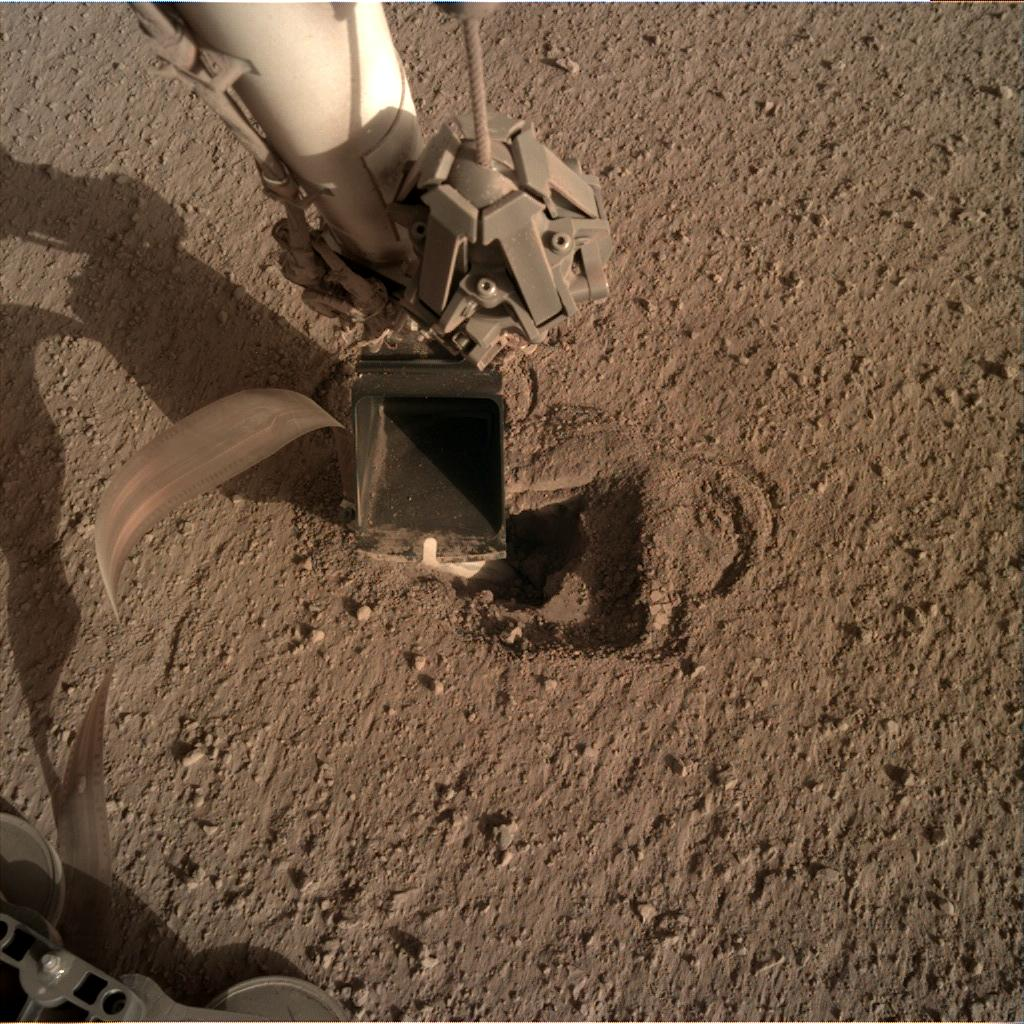 Nasa's Mars lander InSight acquired this image using its Instrument Deployment Camera on Sol 489
