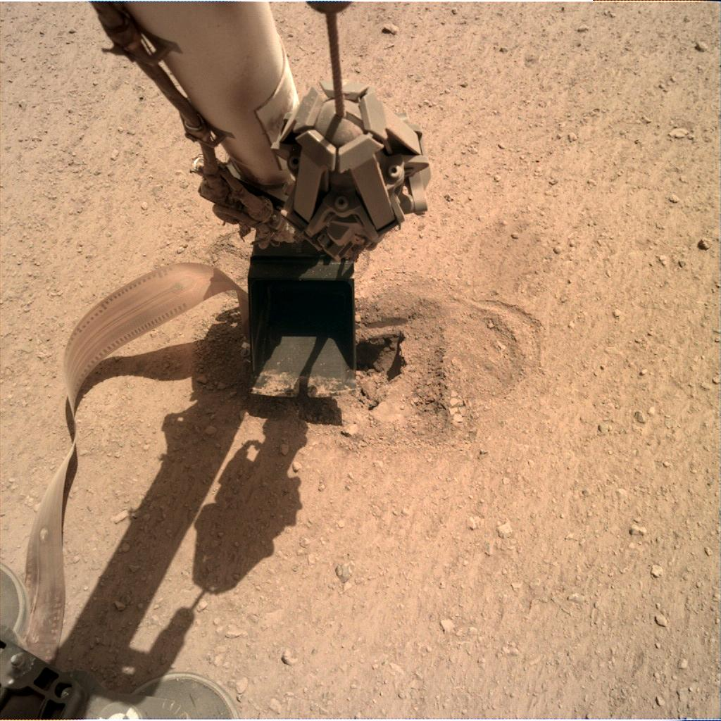 Nasa's Mars lander InSight acquired this image using its Instrument Deployment Camera on Sol 513