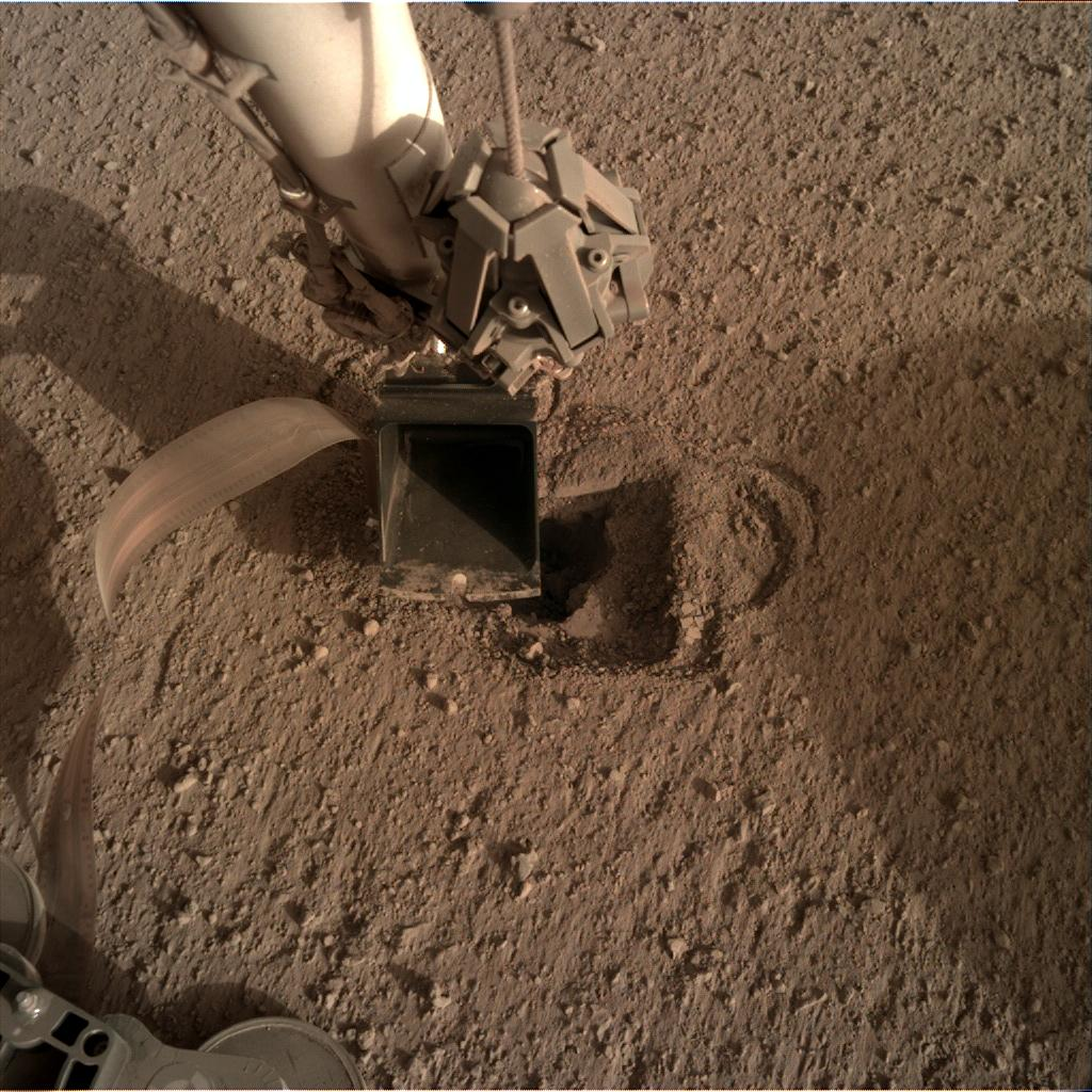 Nasa's Mars lander InSight acquired this image using its Instrument Deployment Camera on Sol 514