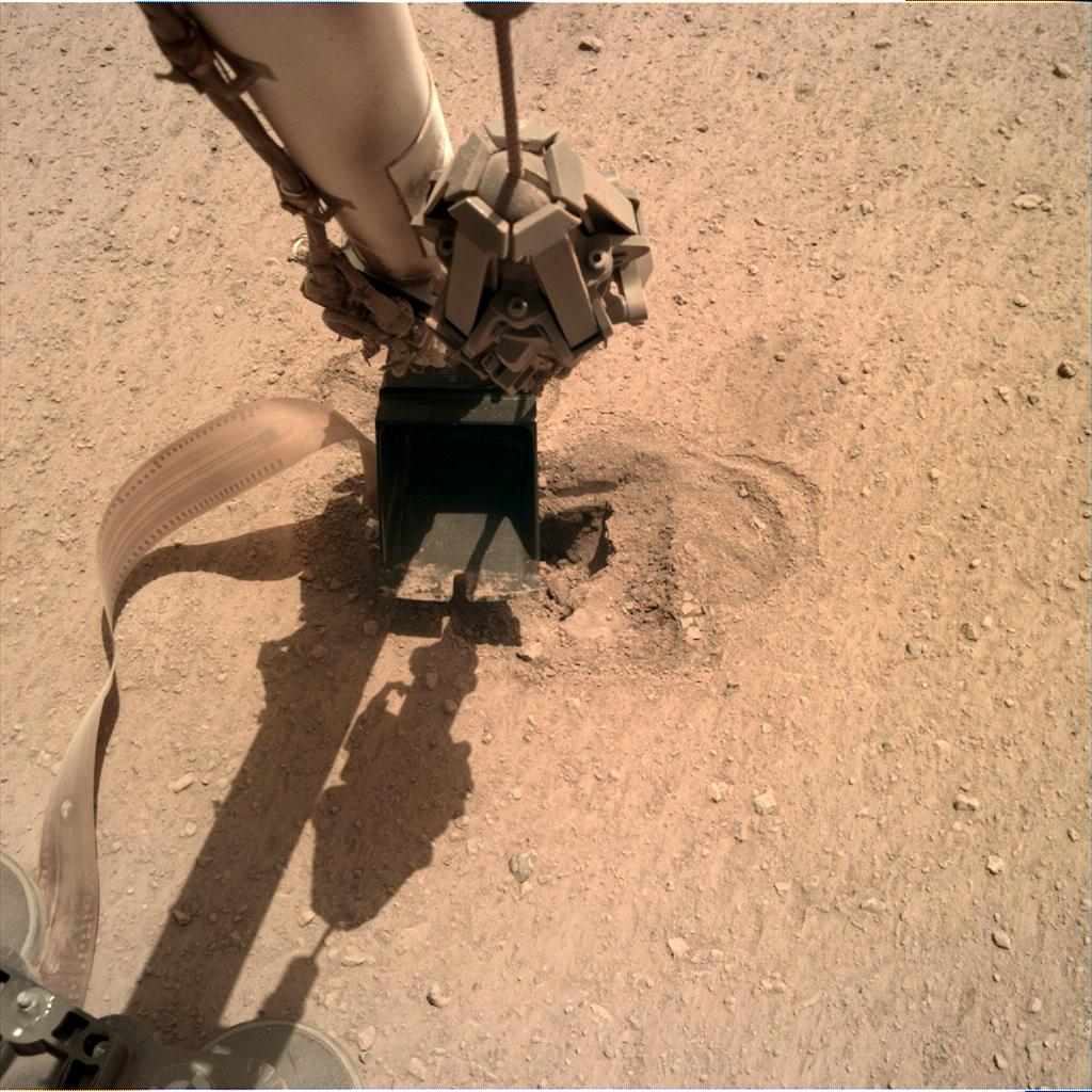 Nasa's Mars lander InSight acquired this image using its Instrument Deployment Camera on Sol 515