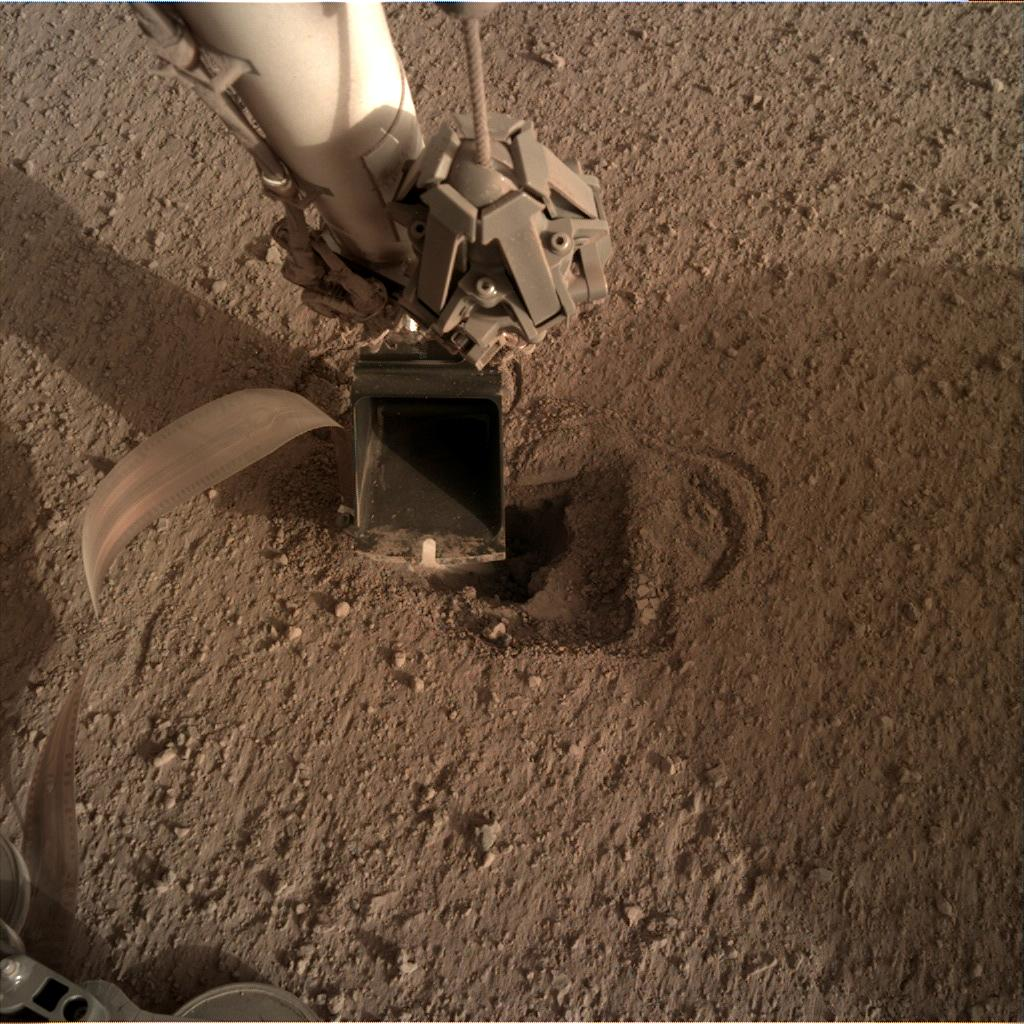 Nasa's Mars lander InSight acquired this image using its Instrument Deployment Camera on Sol 516