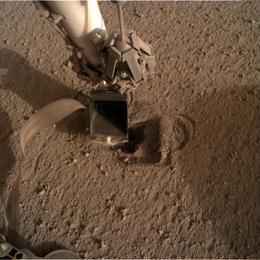 Nasa's Mars lander InSight acquired this image using its Instrument Deployment Camera on Sol 519