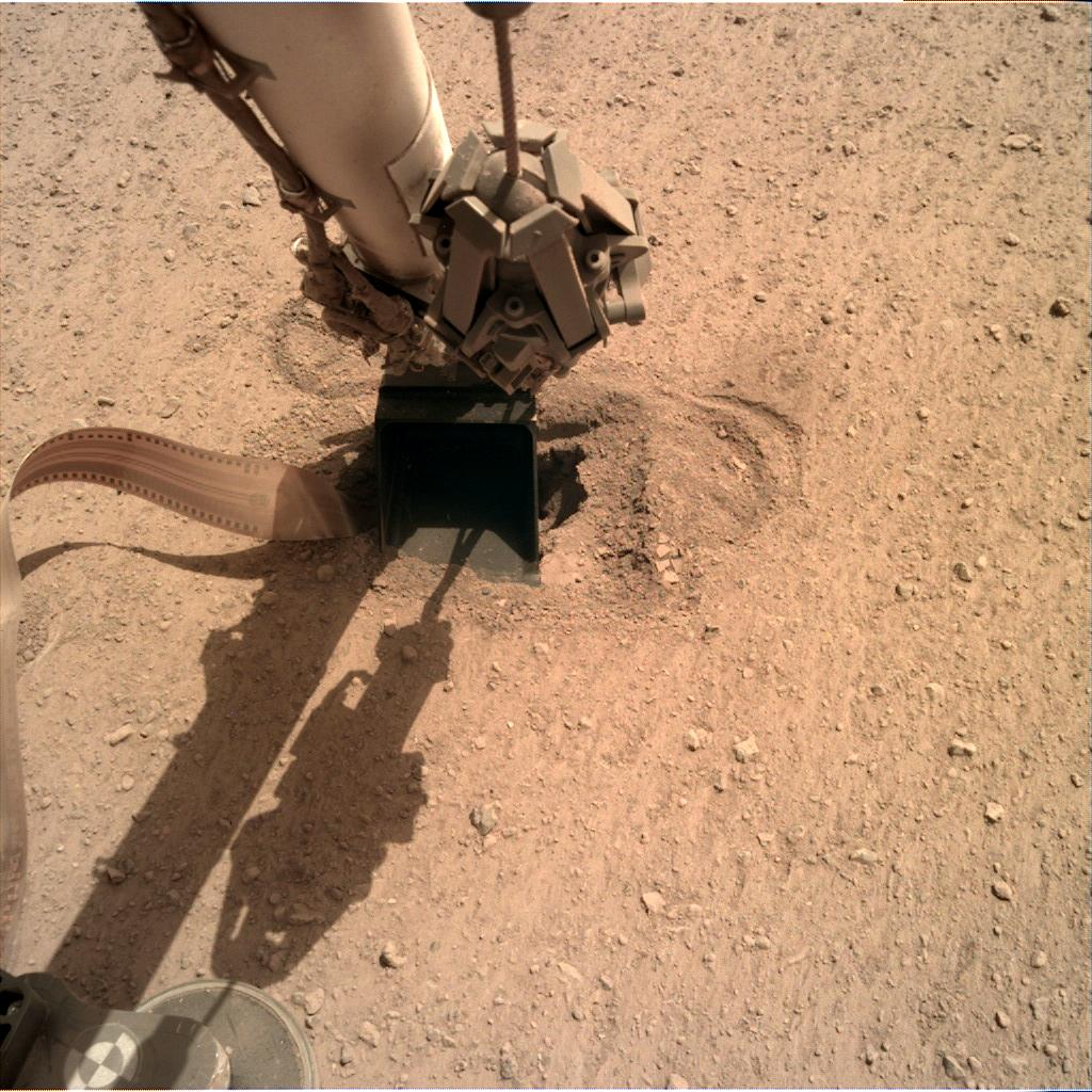 Nasa's Mars lander InSight acquired this image using its Instrument Deployment Camera on Sol 553