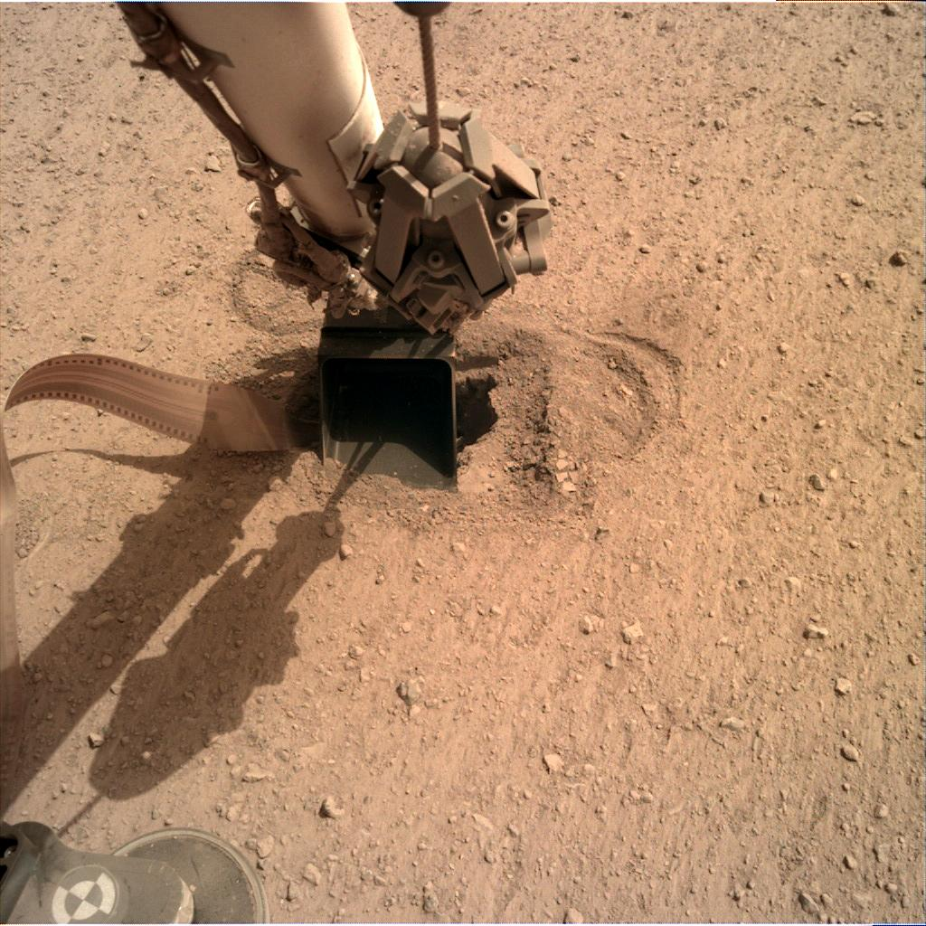 Nasa's Mars lander InSight acquired this image using its Instrument Deployment Camera on Sol 563