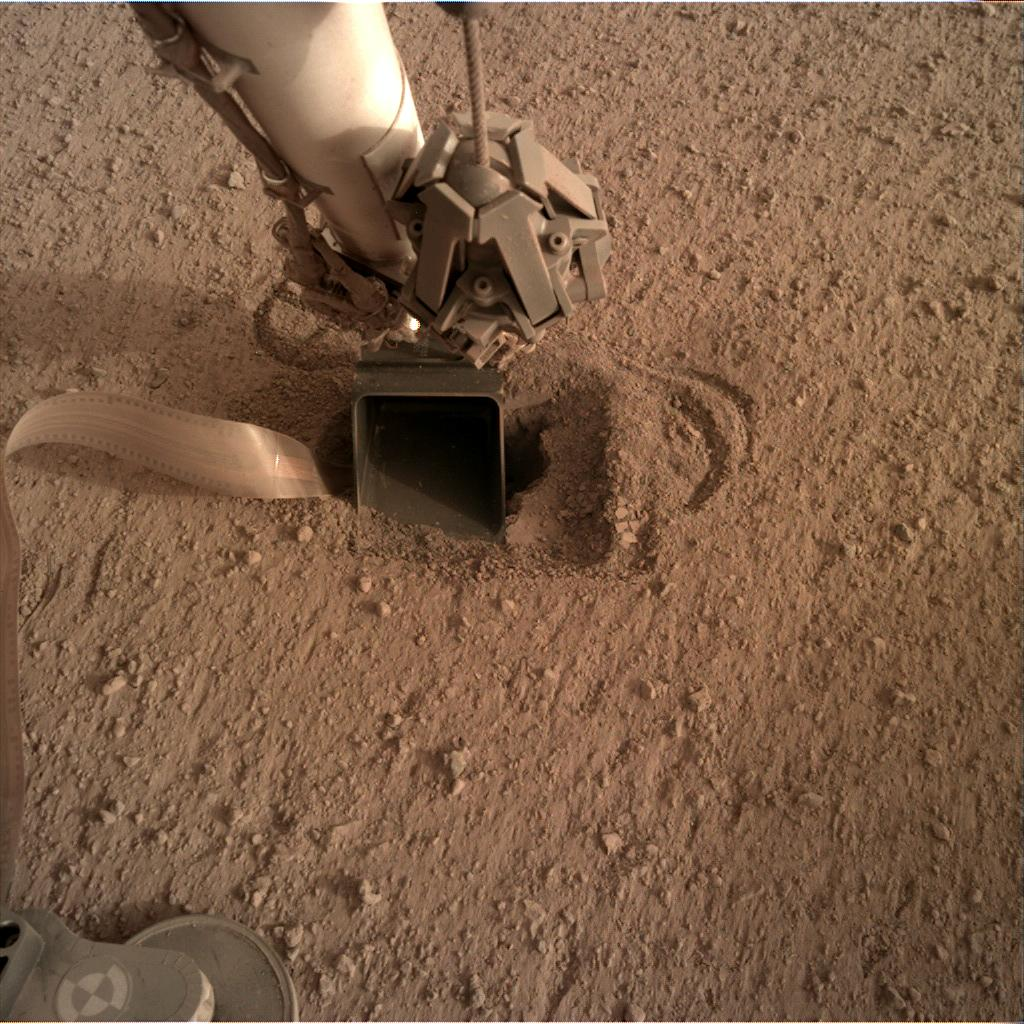 Nasa's Mars lander InSight acquired this image using its Instrument Deployment Camera on Sol 571