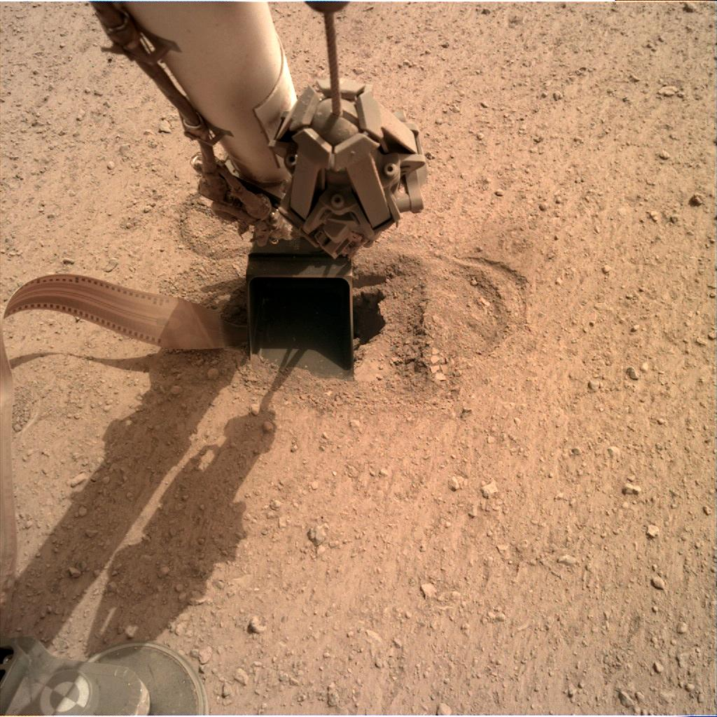 Nasa's Mars lander InSight acquired this image using its Instrument Deployment Camera on Sol 574