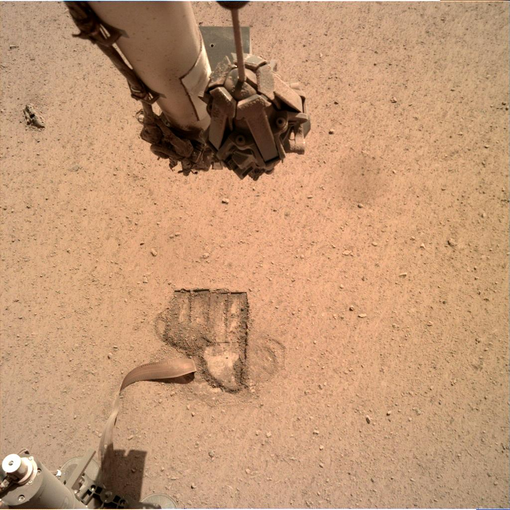 Nasa's Mars lander InSight acquired this image using its Instrument Deployment Camera on Sol 695