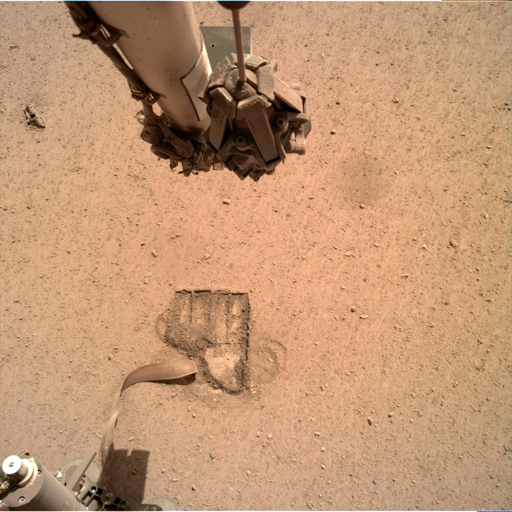 Nasa's Mars lander InSight acquired this image using its Instrument Deployment Camera on Sol 697