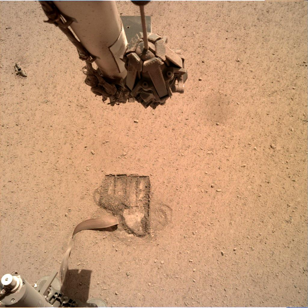 Nasa's Mars lander InSight acquired this image using its Instrument Deployment Camera on Sol 699