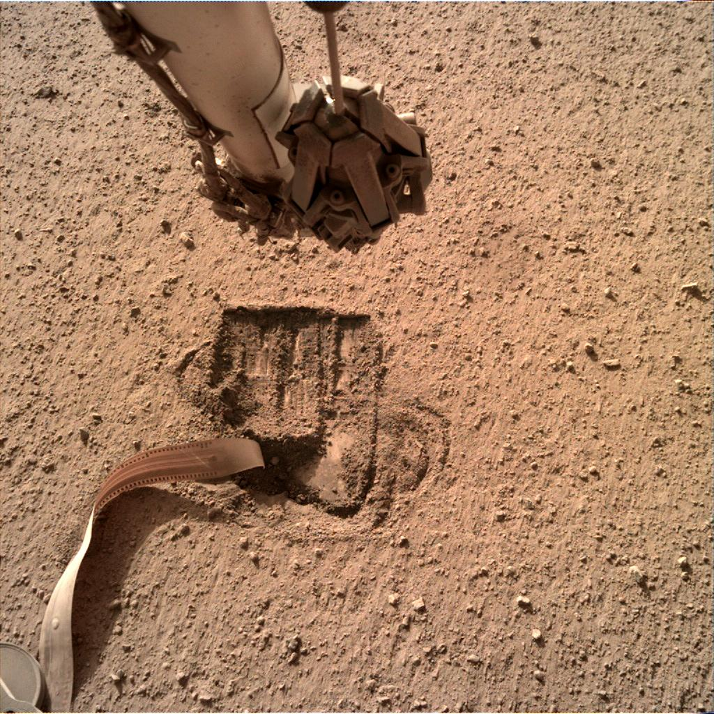 Nasa's Mars lander InSight acquired this image using its Instrument Deployment Camera on Sol 701