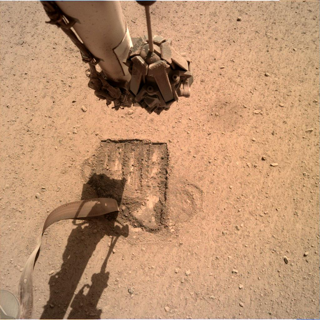 Nasa's Mars lander InSight acquired this image using its Instrument Deployment Camera on Sol 702