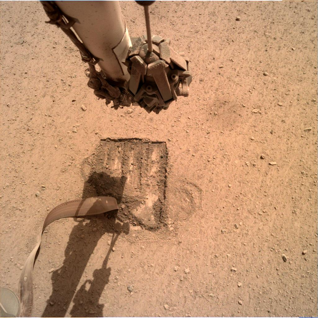 Nasa's Mars lander InSight acquired this image using its Instrument Deployment Camera on Sol 706