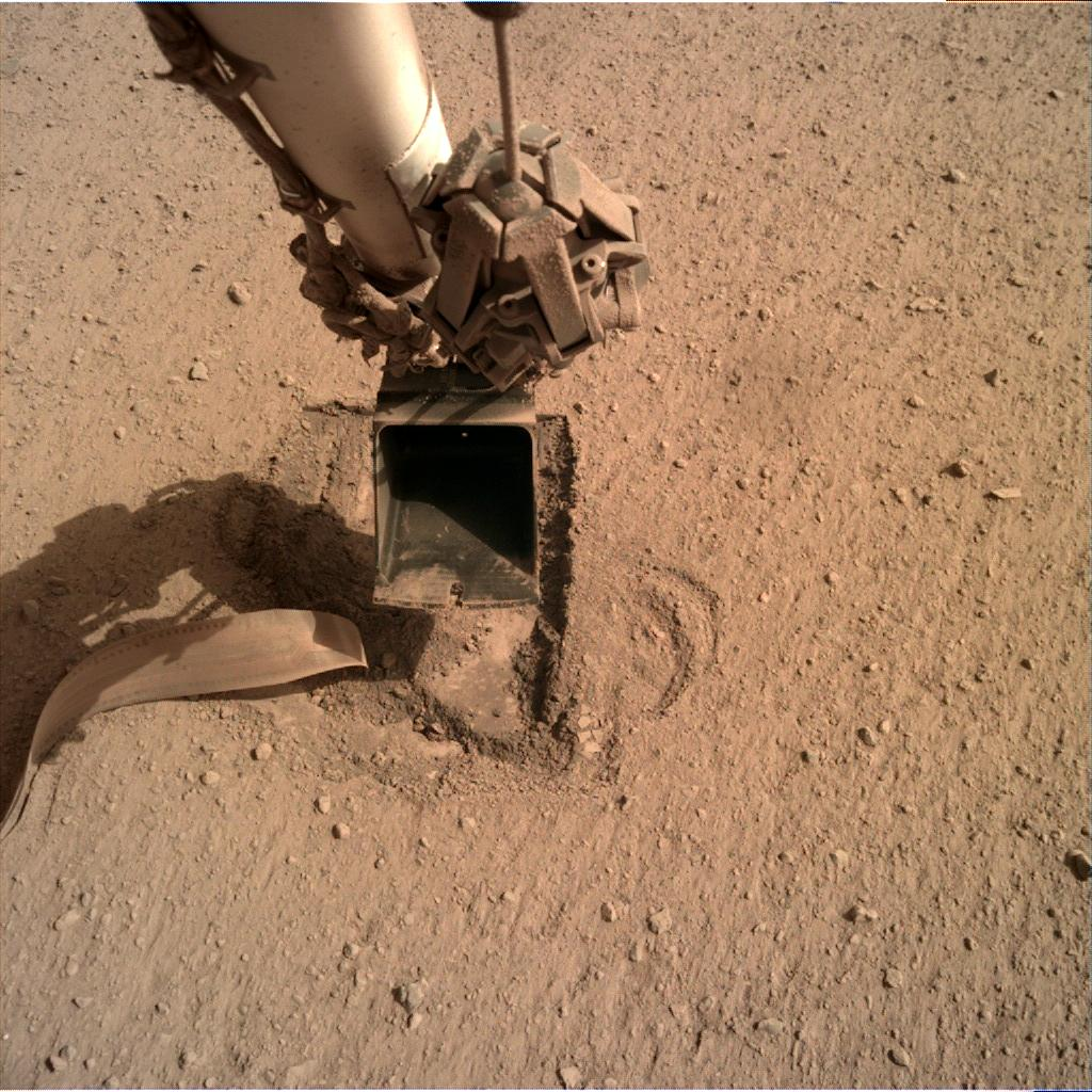 Nasa's Mars lander InSight acquired this image using its Instrument Deployment Camera on Sol 707