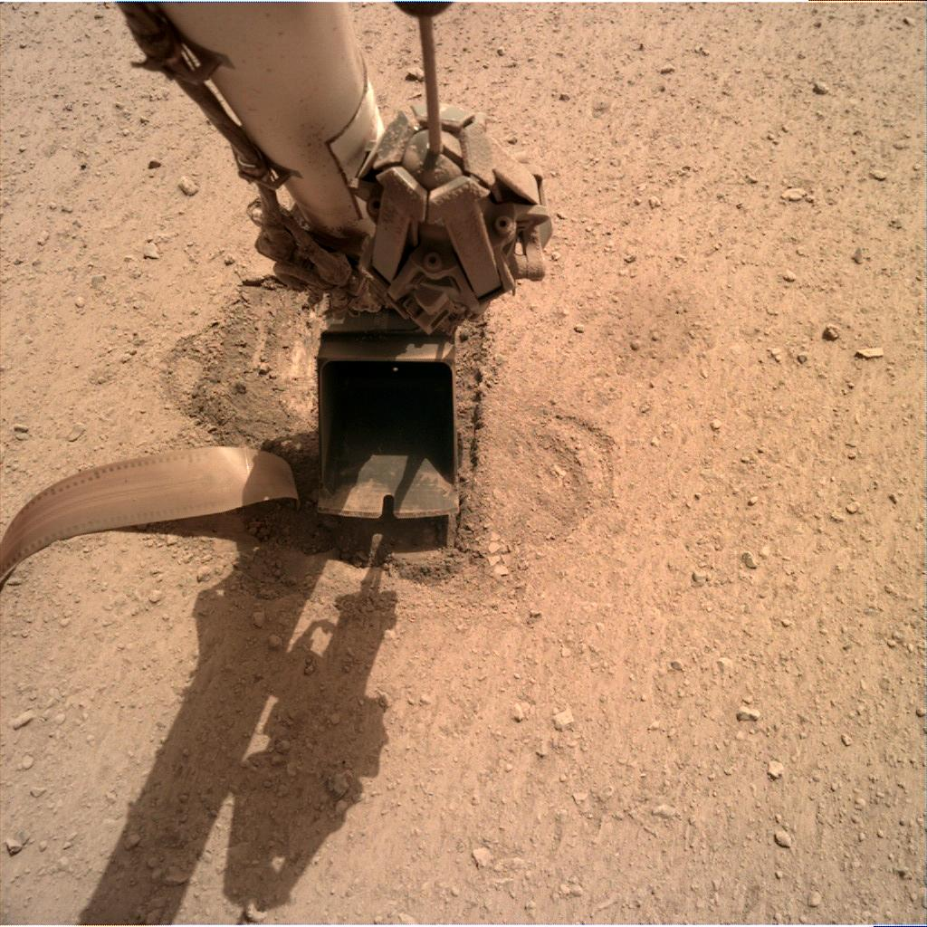 Nasa's Mars lander InSight acquired this image using its Instrument Deployment Camera on Sol 718