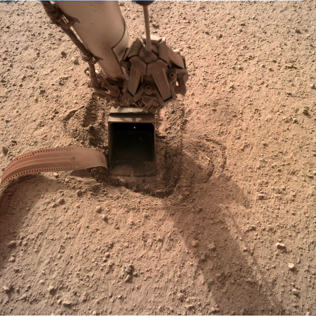 Nasa's Mars lander InSight acquired this image using its Instrument Deployment Camera on Sol 735