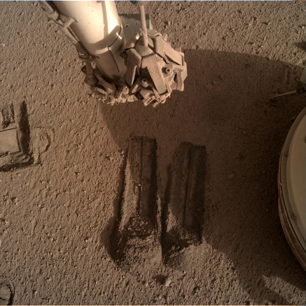 Nasa's Mars lander InSight acquired this image using its Instrument Deployment Camera on Sol 808