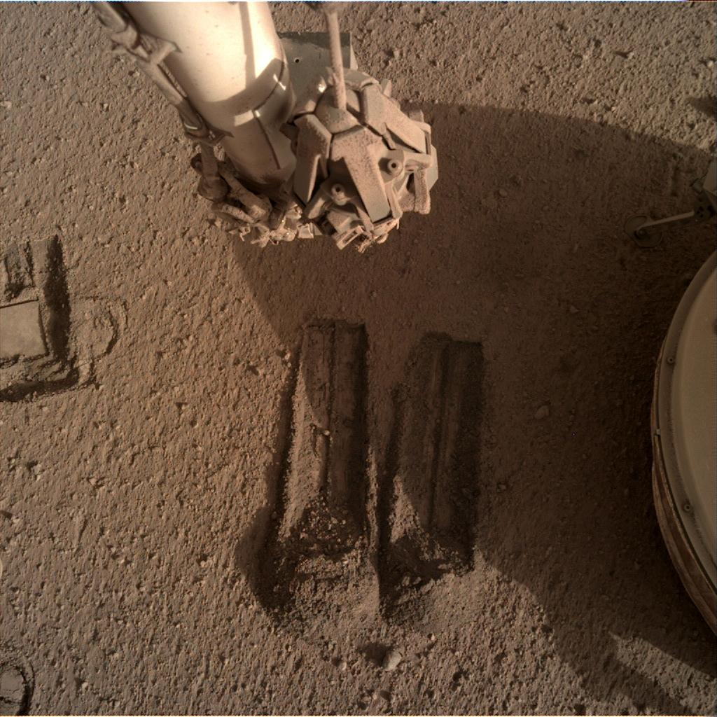 Nasa's Mars lander InSight acquired this image using its Instrument Deployment Camera on Sol 814