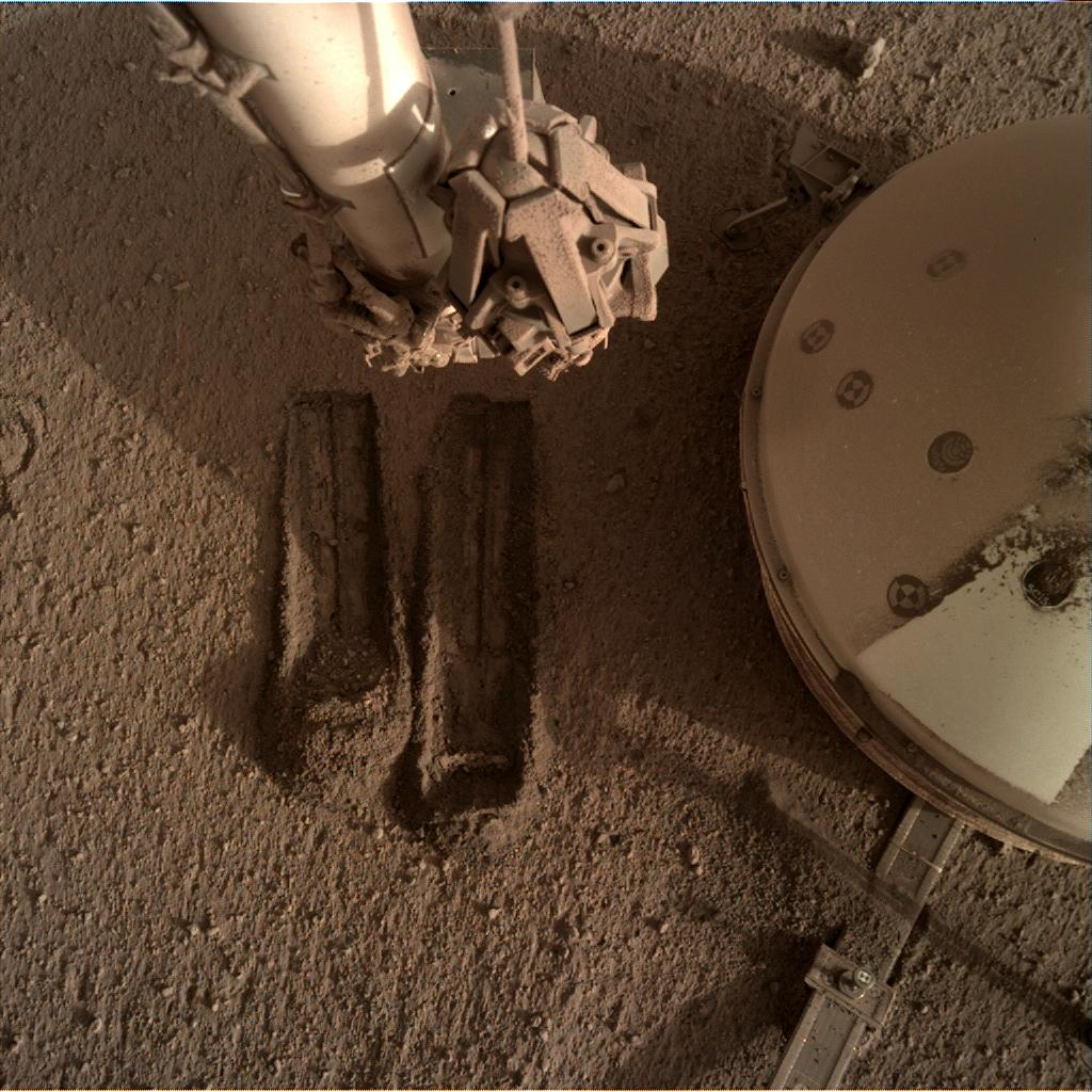 Nasa's Mars lander InSight acquired this image using its Instrument Deployment Camera on Sol 817