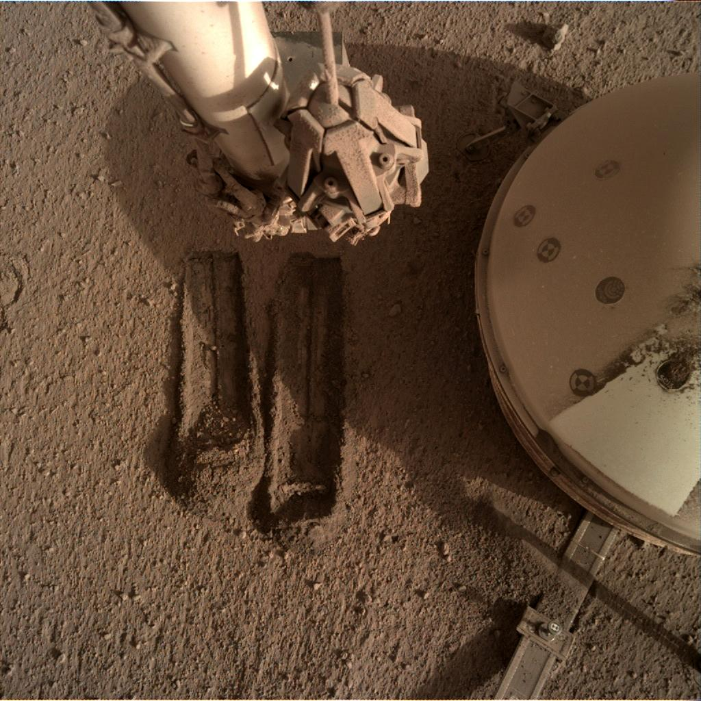 Nasa's Mars lander InSight acquired this image using its Instrument Deployment Camera on Sol 819