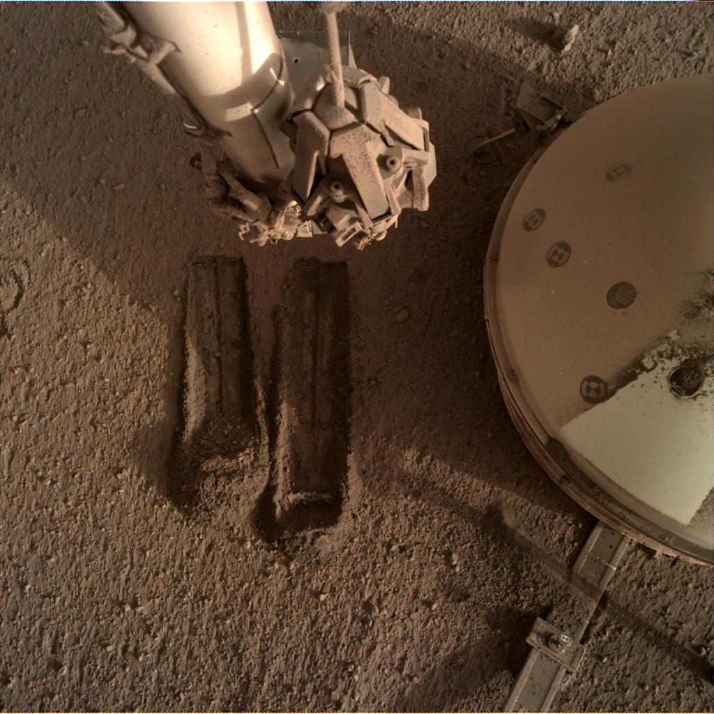 Nasa's Mars lander InSight acquired this image using its Instrument Deployment Camera on Sol 821