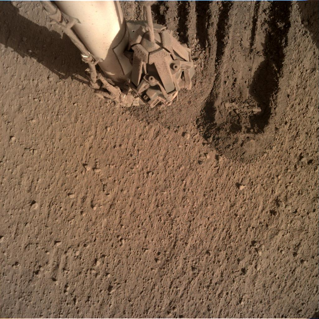 Nasa's Mars lander InSight acquired this image using its Instrument Deployment Camera on Sol 822
