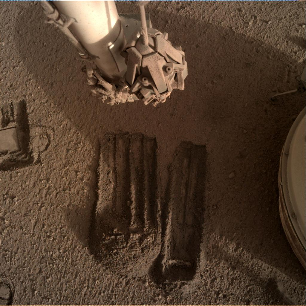 Nasa's Mars lander InSight acquired this image using its Instrument Deployment Camera on Sol 823