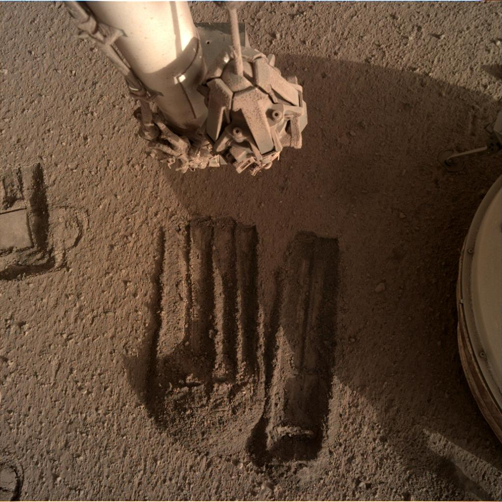 Nasa's Mars lander InSight acquired this image using its Instrument Deployment Camera on Sol 825