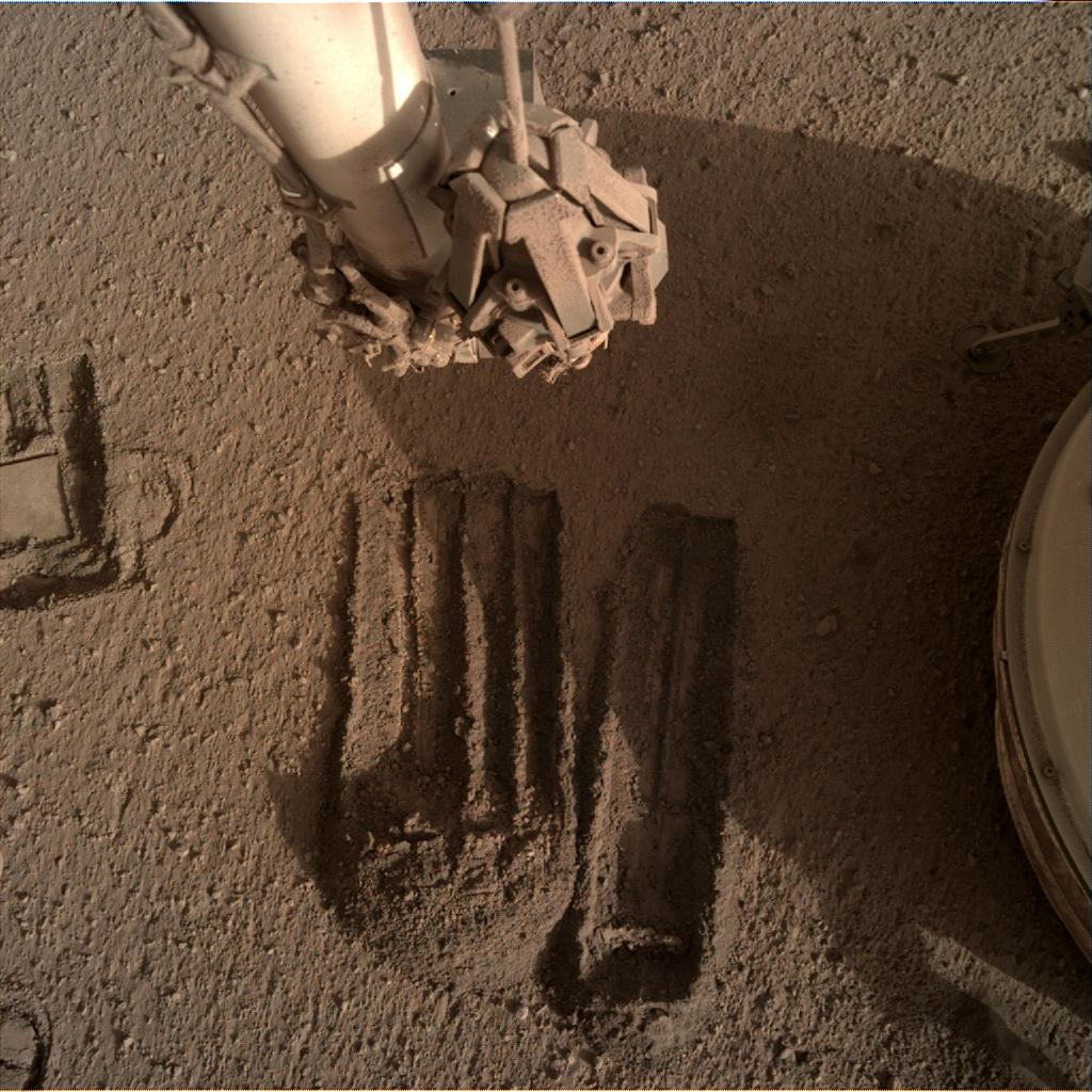 Nasa's Mars lander InSight acquired this image using its Instrument Deployment Camera on Sol 827