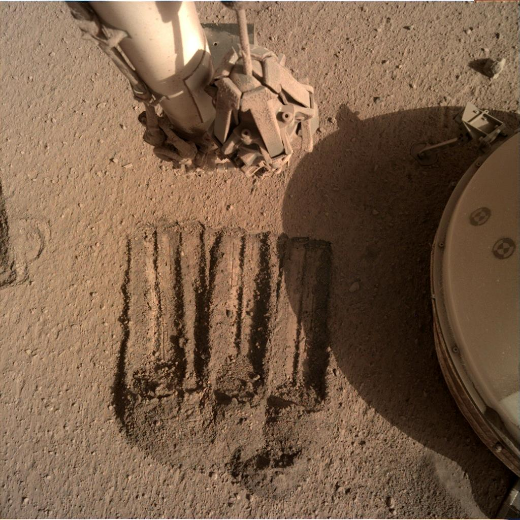 Nasa's Mars lander InSight acquired this image using its Instrument Deployment Camera on Sol 829
