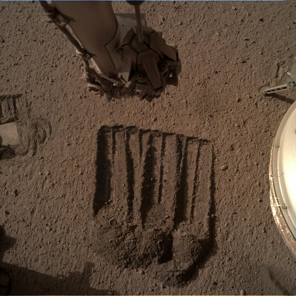 Nasa's Mars lander InSight acquired this image using its Instrument Deployment Camera on Sol 830