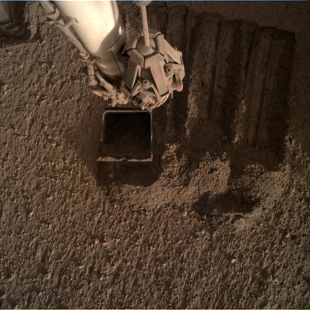 Nasa's Mars lander InSight acquired this image using its Instrument Deployment Camera on Sol 843