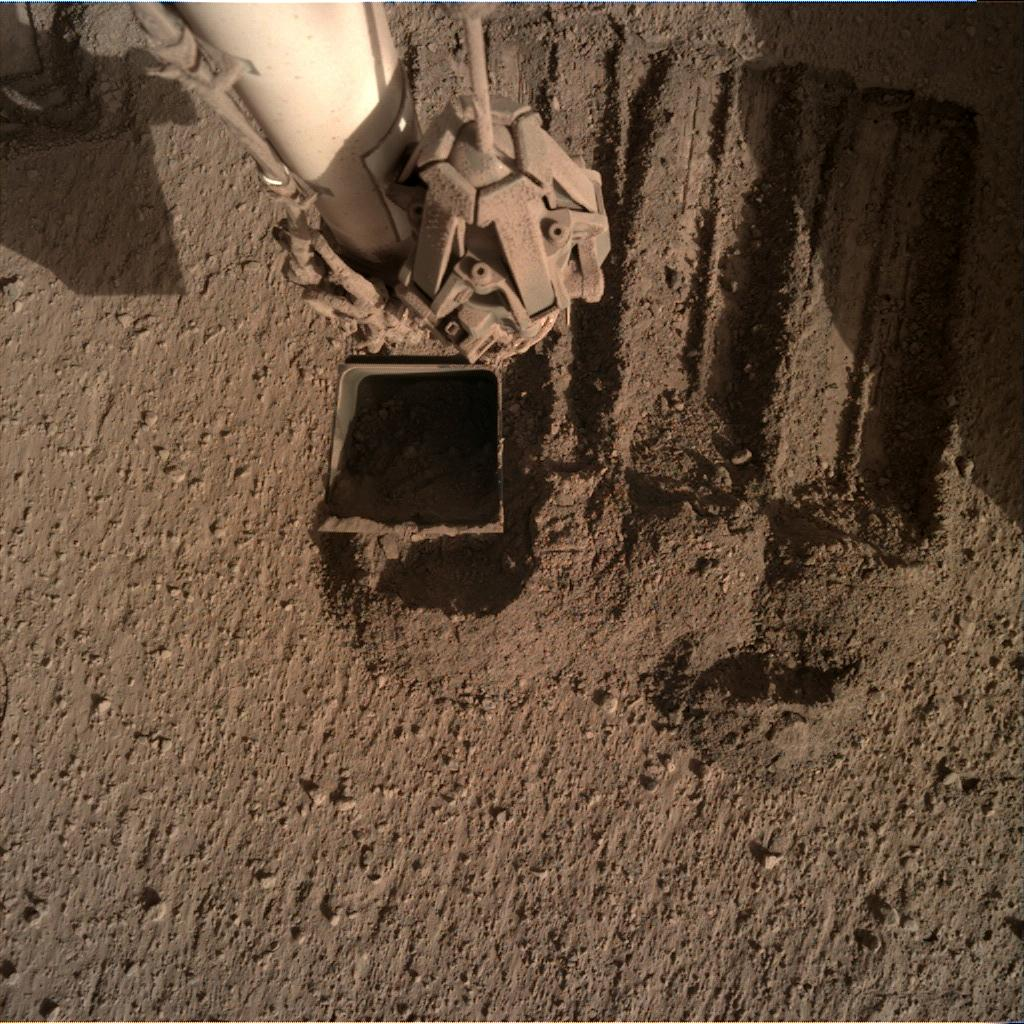 Nasa's Mars lander InSight acquired this image using its Instrument Deployment Camera on Sol 844