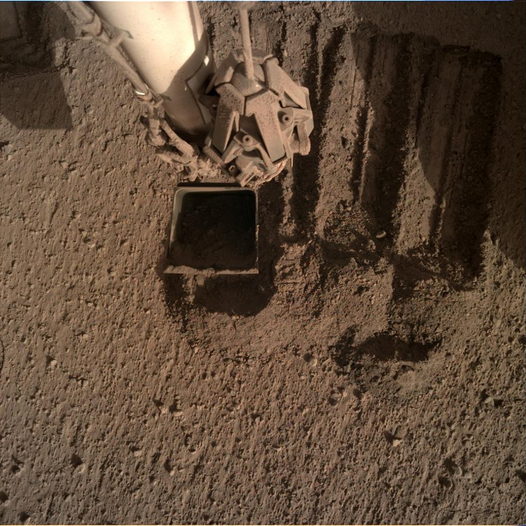 Nasa's Mars lander InSight acquired this image using its Instrument Deployment Camera on Sol 848
