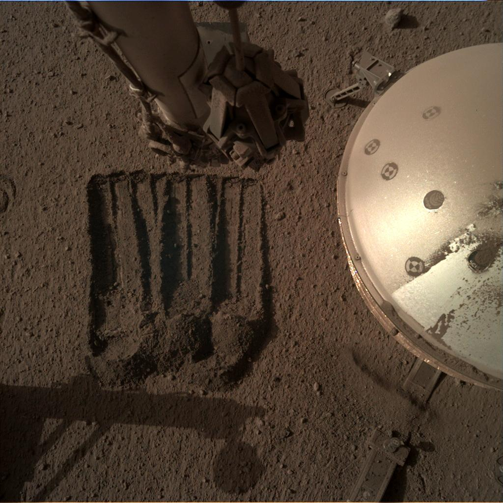 Nasa's Mars lander InSight acquired this image using its Instrument Deployment Camera on Sol 851