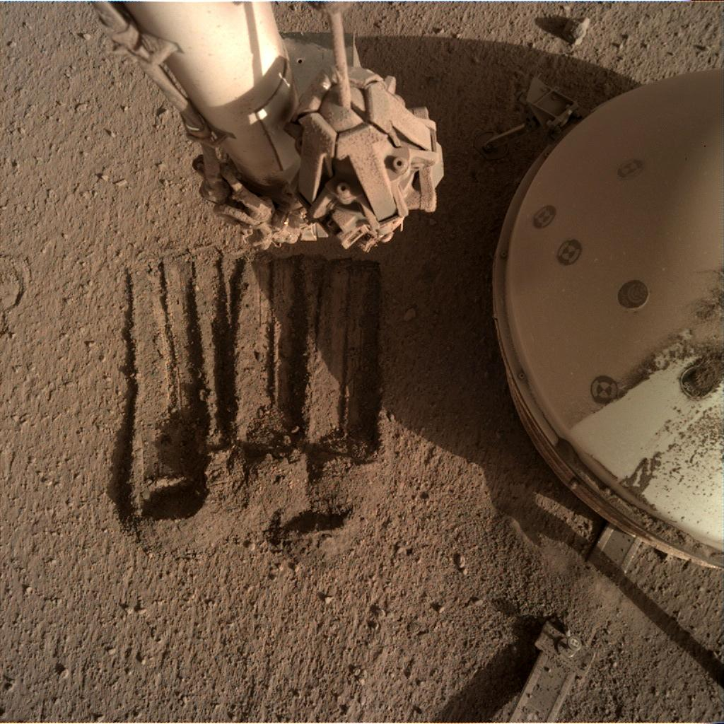 Nasa's Mars lander InSight acquired this image using its Instrument Deployment Camera on Sol 852
