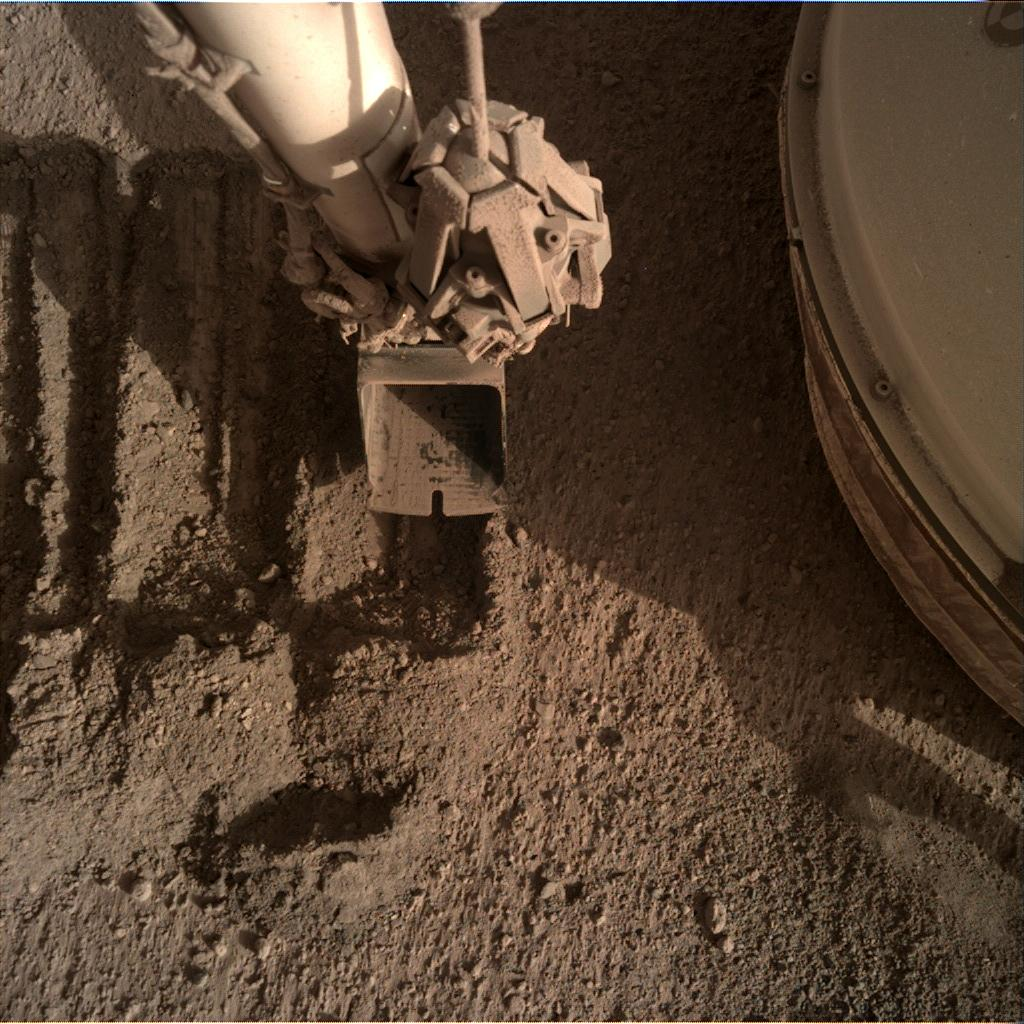 Nasa's Mars lander InSight acquired this image using its Instrument Deployment Camera on Sol 856