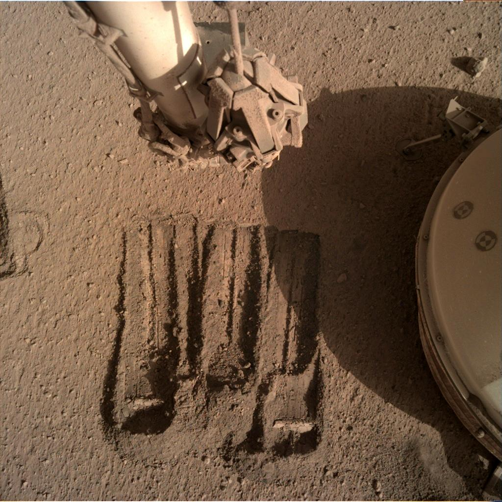 Nasa's Mars lander InSight acquired this image using its Instrument Deployment Camera on Sol 857