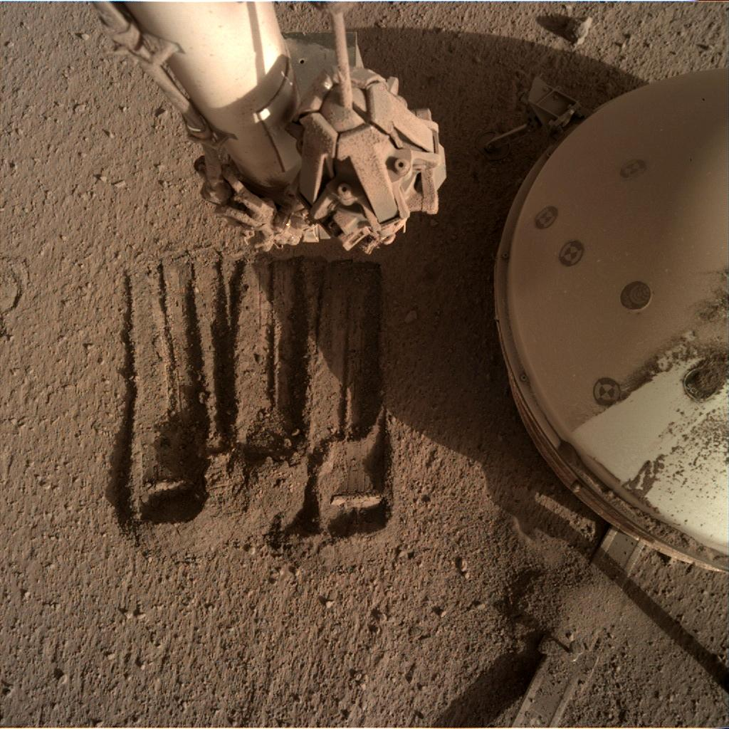 Nasa's Mars lander InSight acquired this image using its Instrument Deployment Camera on Sol 858