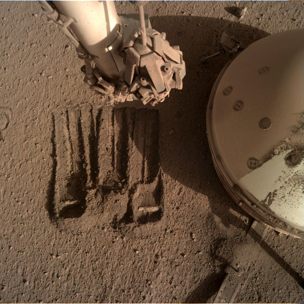 Nasa's Mars lander InSight acquired this image using its Instrument Deployment Camera on Sol 860