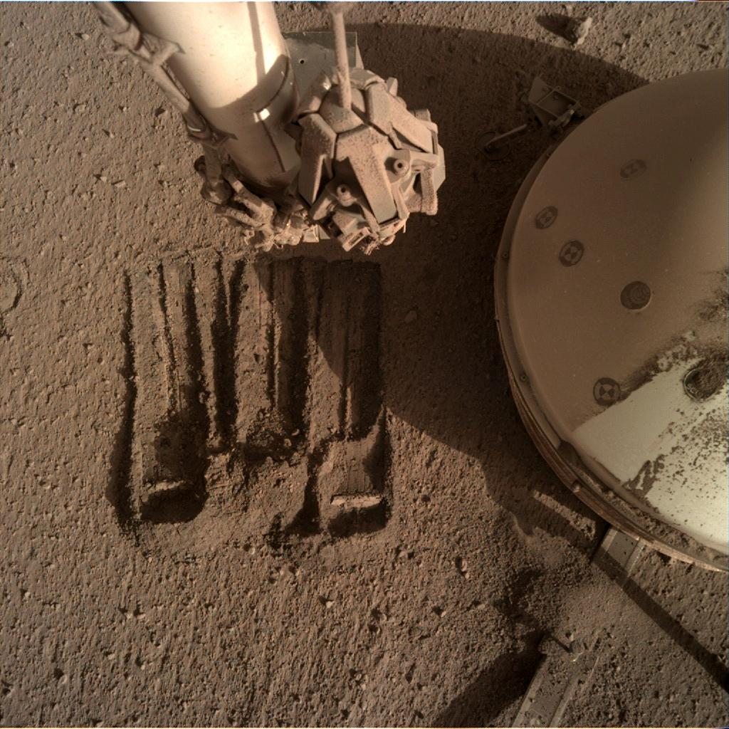 Nasa's Mars lander InSight acquired this image using its Instrument Deployment Camera on Sol 861
