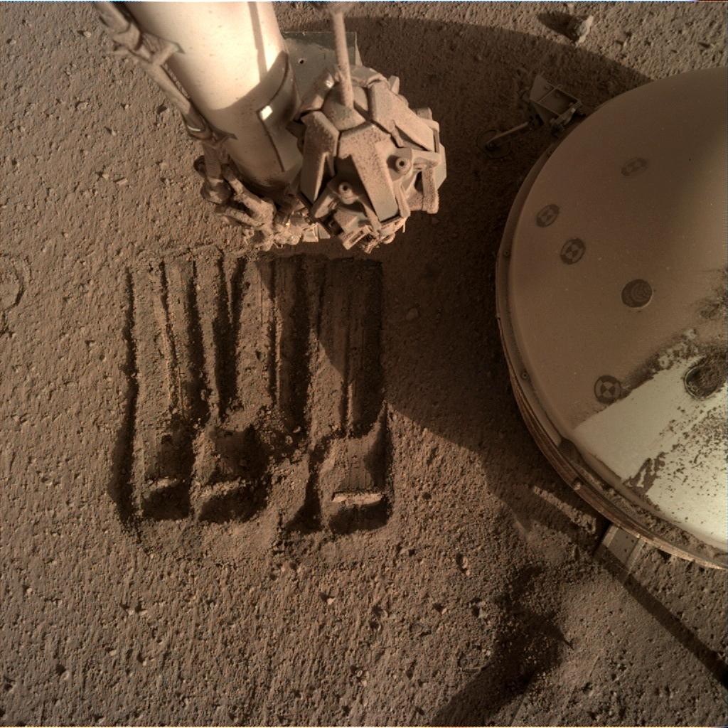 Nasa's Mars lander InSight acquired this image using its Instrument Deployment Camera on Sol 864